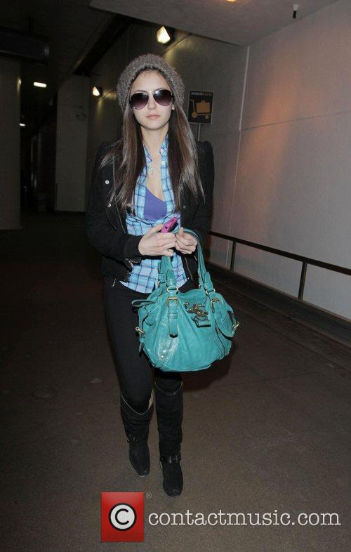 Nina Dobrev arriving at LAX on a Delta...