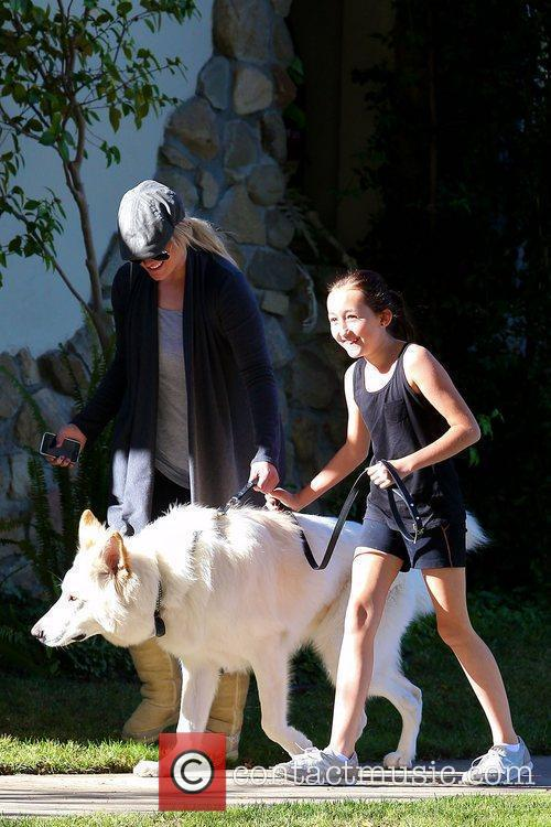 Actress Noah Cyrus walking her dog in Toluca...