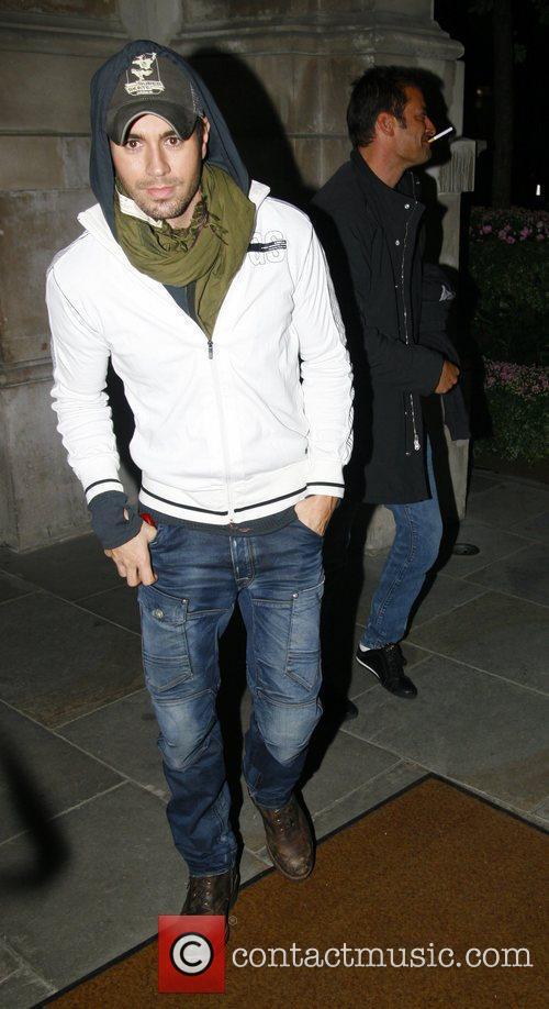 Enrique Iglesias at Nobu restaurant wearing jeans, hoodie...