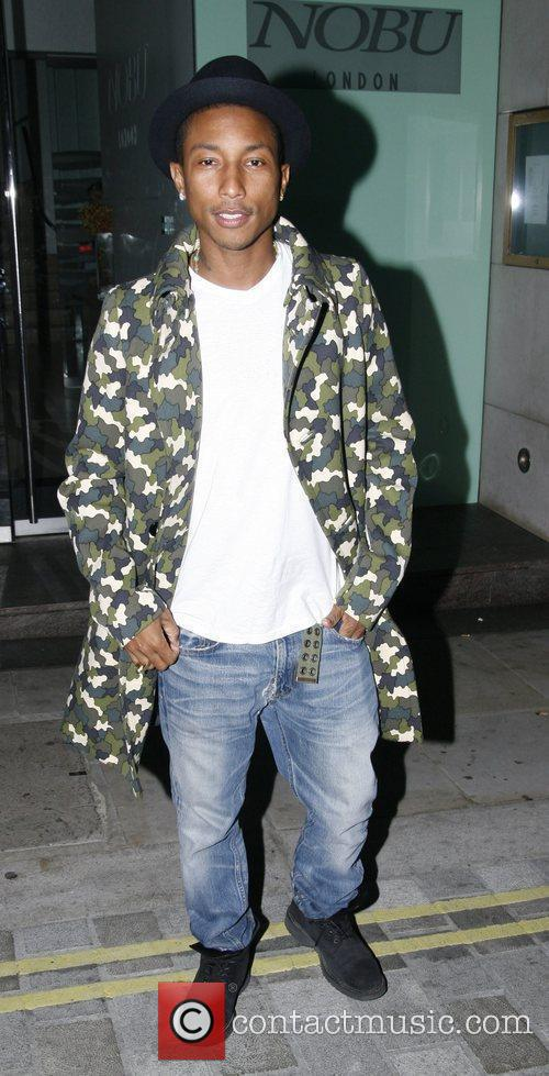 Pharrell Williams in a designer camouflage coat leaves...