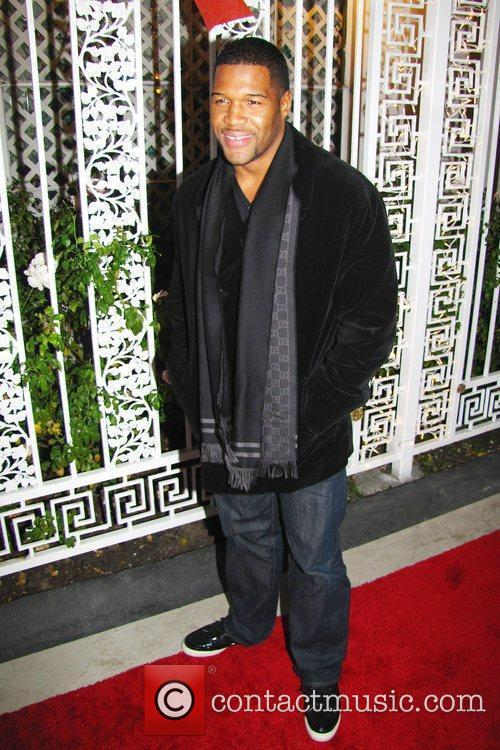 Michael Strahan Norwood Young's annual White Christmas Party...