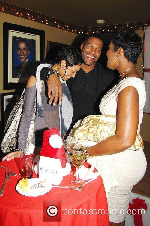 Michael Strahan and Nicole Murphy and guest Norwood...