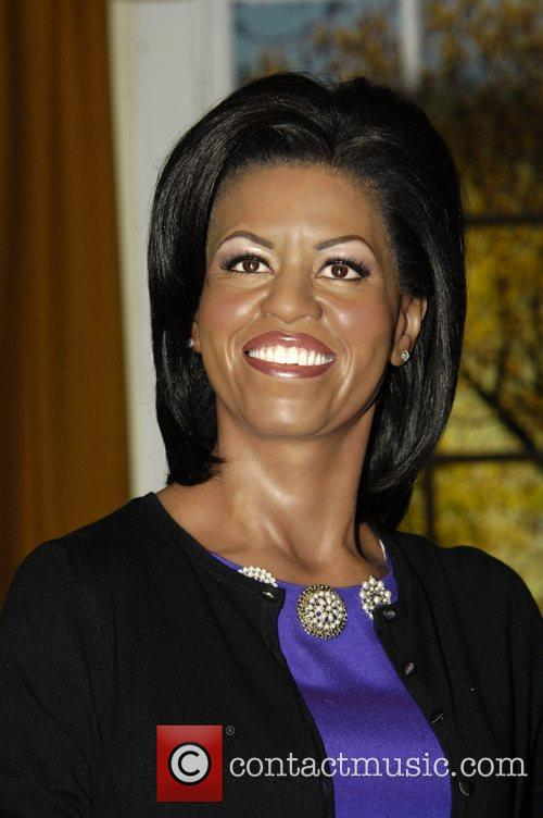 A waxwork of Michelle Obama is unveiled at...