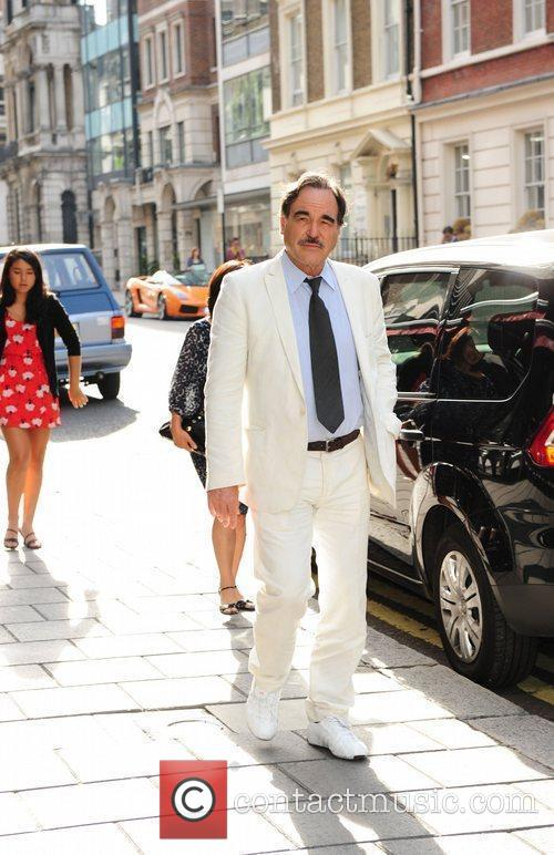 Oliver Stone with his wife Sun-jung Jung and...