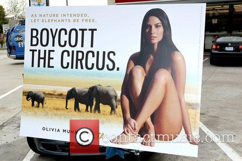 Atmosphere Olivia Munn showing off her new PETA...