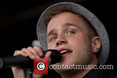 Olly Murs performing at Kempton Park Racecourse.