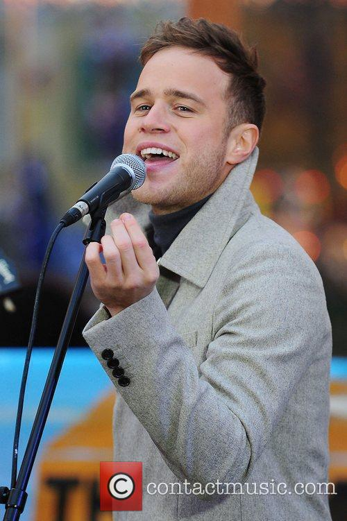 Olly Murs skating on the ice rink and...