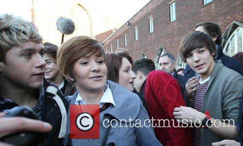 Niall Horan and Louis Tomlinson with fans 'The...