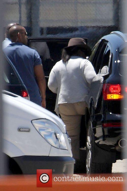 Oprah Winfrey gets into an awaiting car after...