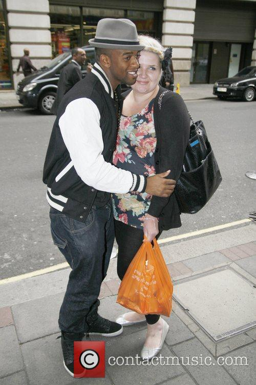 Oritse Williams of JLS greets a fan outside...