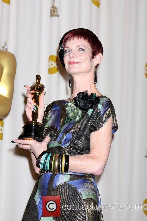 Costume designer Sandy Powell, winner of Best Costume...