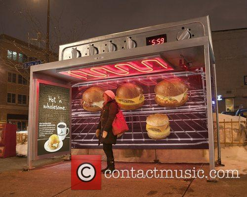 Bus Shelter Ad Keeps Commuters Warm While They...