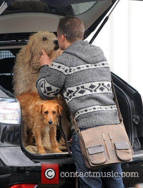 Graham Norton kisses his dog as he arrives...