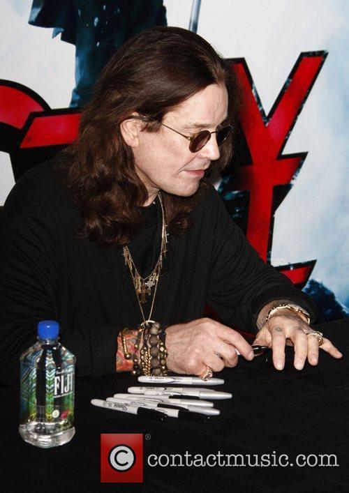 Ozzy Osbourne signs copies of his new album...