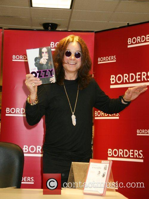 Signs copies of his new book 'I Am...