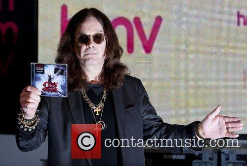 Ozzy Osbourne signs copies of his new CD...