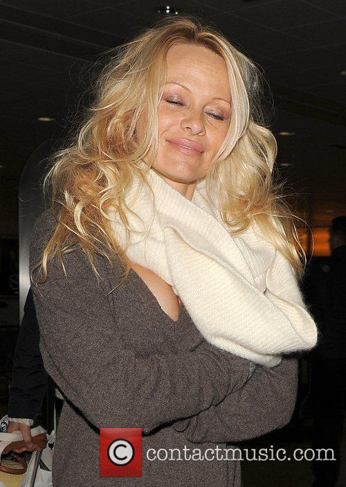 Pamela Anderson  arriving at Heathrow Airport. She...