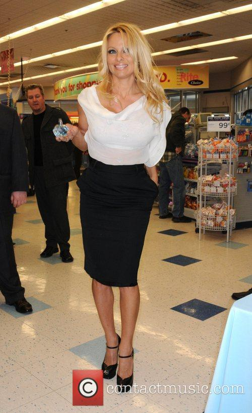 Promotes her new fragrance Malibu at Rite-Aid