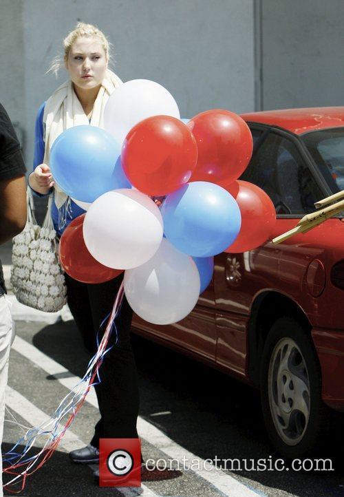 David Hasselhoff 's daughter Hayley Hasselhoff taking balloons...