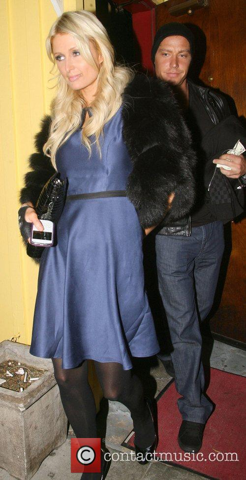 Paris Hilton and her boyfriend Cy Waits are...