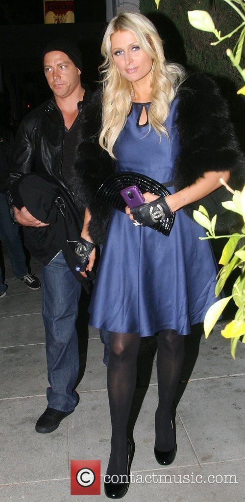 Paris Hilton and her boyfriend Cy Waits are...