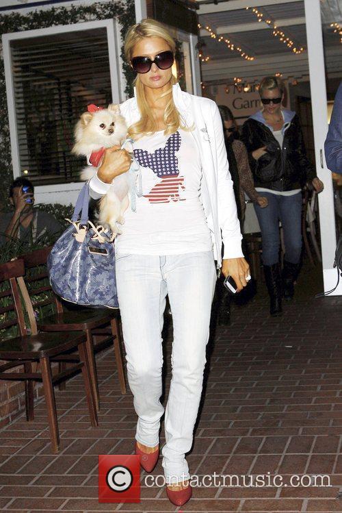 Paris Hilton holds her Pomerainian dog named 'Marilyn...
