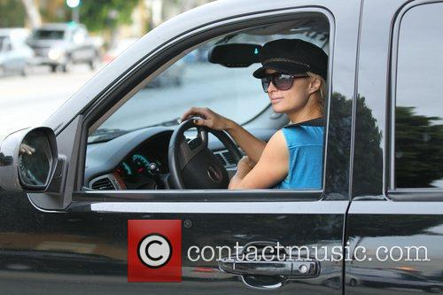Paris Hilton drives away from Samy's Camera store...