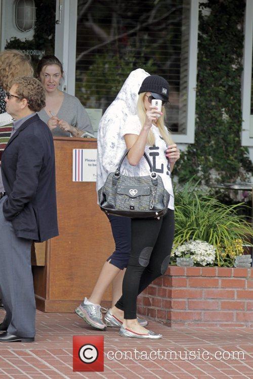 Paris Hilton and a friend depart Fred Segal...