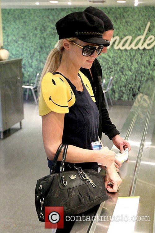 Paris Hilton and Cy Waits Paris Hilton waiting...