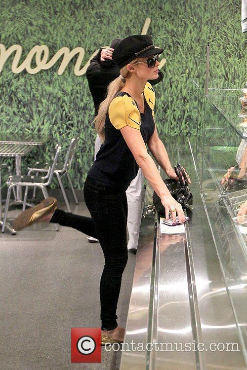 Paris Hilton  waiting with her boyfriend to...