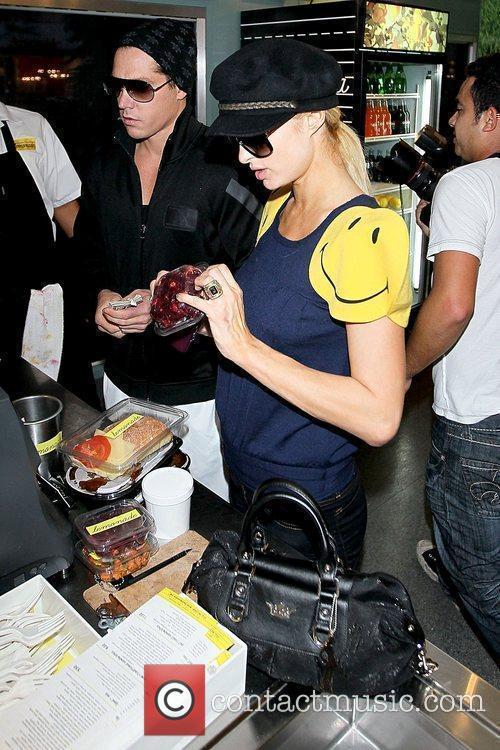 Cy Waits and Paris Hilton Paris Hilton waiting...