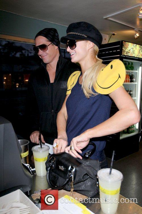 Cy Waits and Paris Hilton Paris Hilton picking...