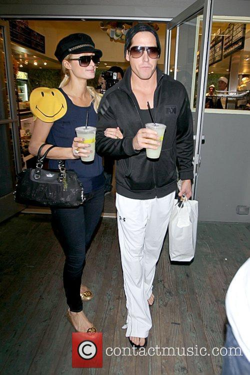 Paris Hilton and Cy Waits Paris Hilton picking...