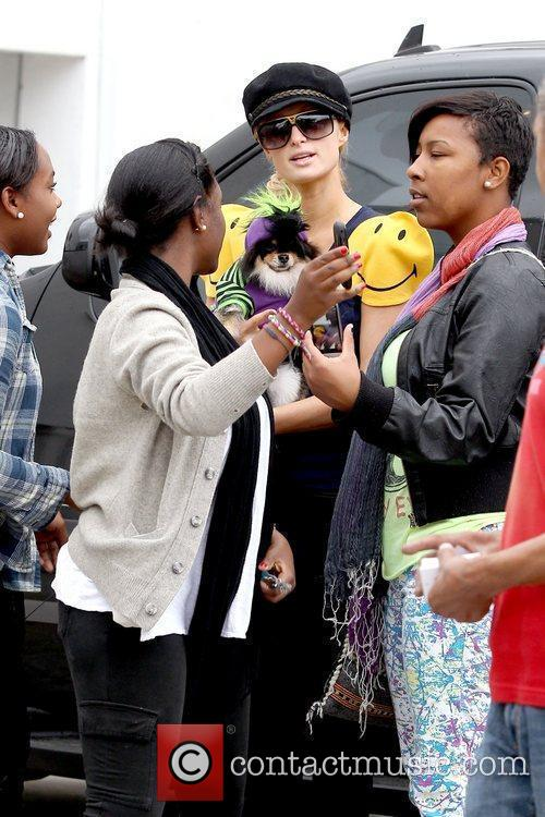 Paris Hilton talking with fans after shopping for...