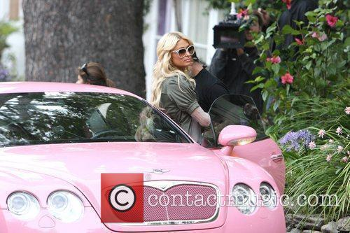 Paris Hilton with her pink Bentley during filming...