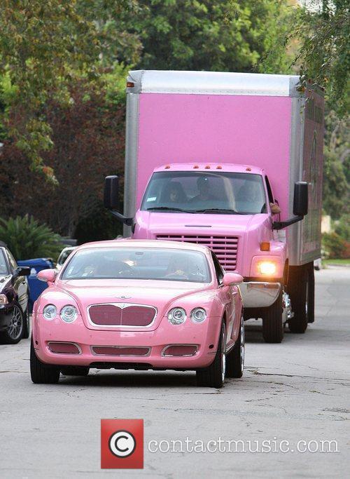 Paris Hilton arrives in her pink Bentley during...