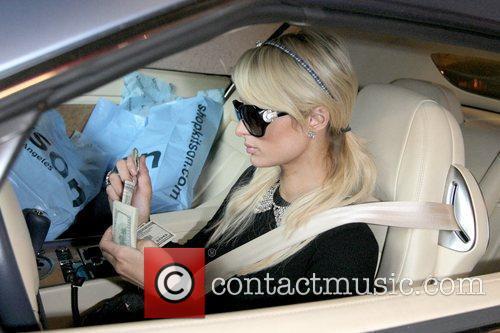 Paris Hilton paying the parking valet Paris Hilton...