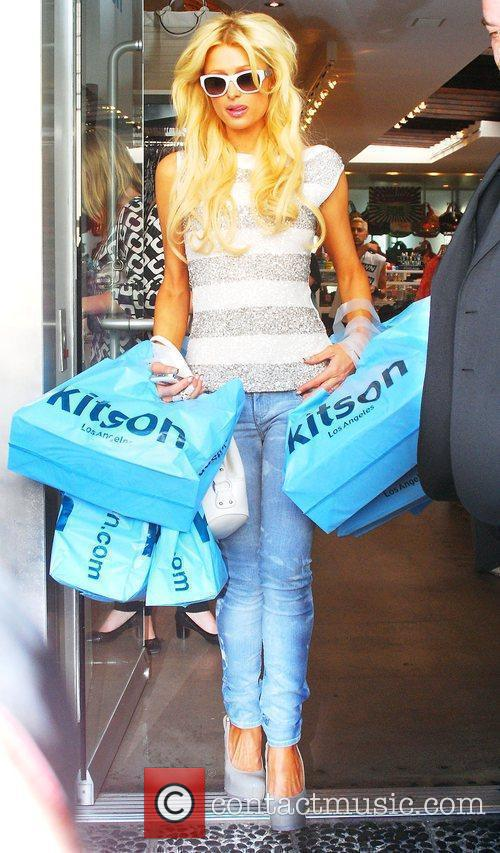 Leaving Kitson on Robertson Boulevard with her hands...