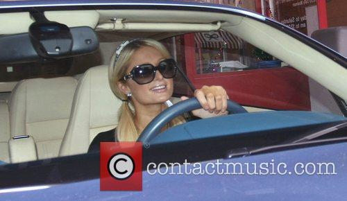 Paris Hilton drives off after shopping for last...