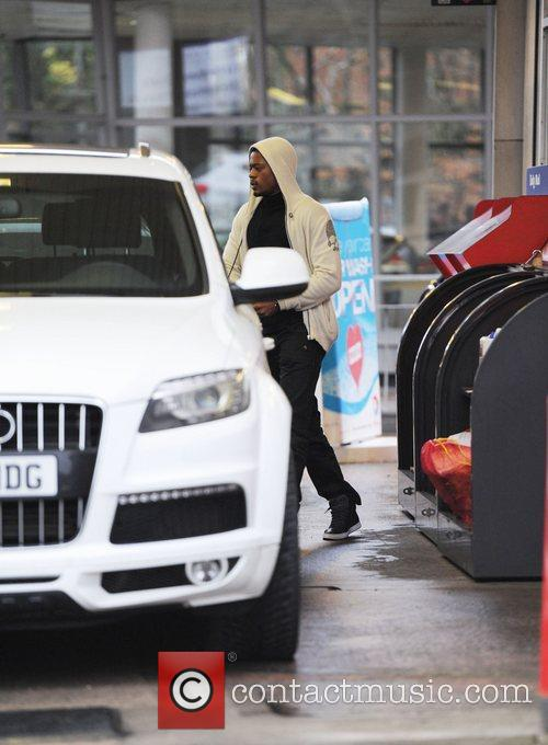 Footballer Patrice Evra fills his car with fuel...