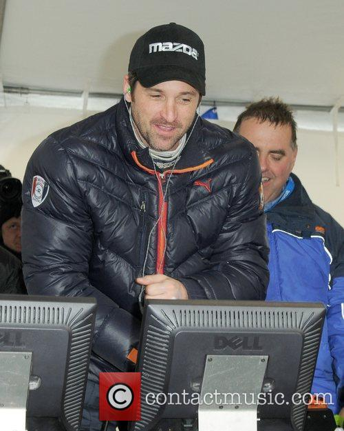 Watches Dempsey Racings No. 40 Mazda RX8 complete...