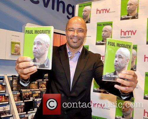 Retired Irish football legend signs copies of his...