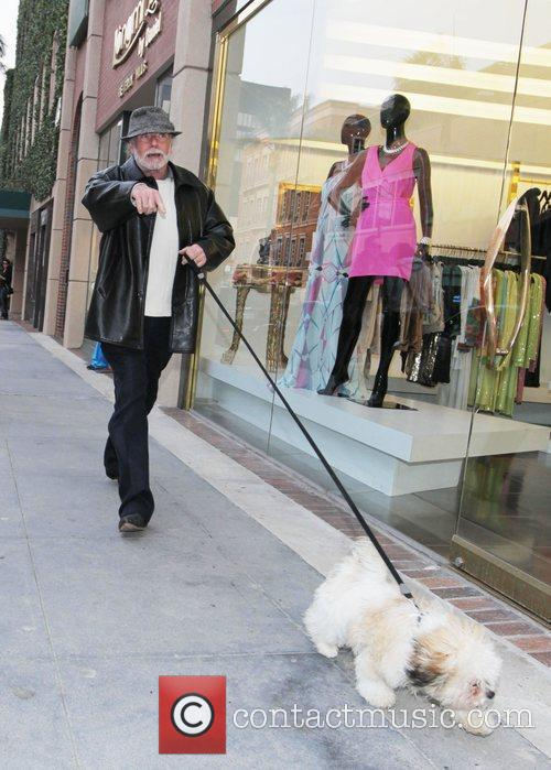 Walks his dog in Beverly Hills