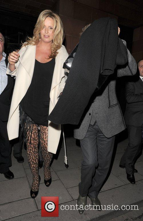Rod Stewart comes over all camera shy, as...