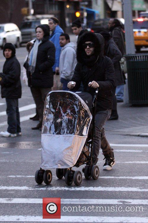Pete Wentz and Bronx seen out braving the...