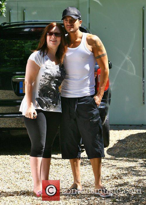 Peter Andre posing with a fan as he...