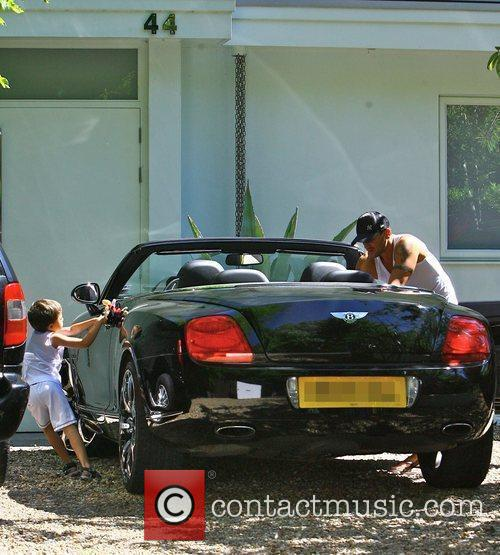 Peter Andre leaving his house with his son...