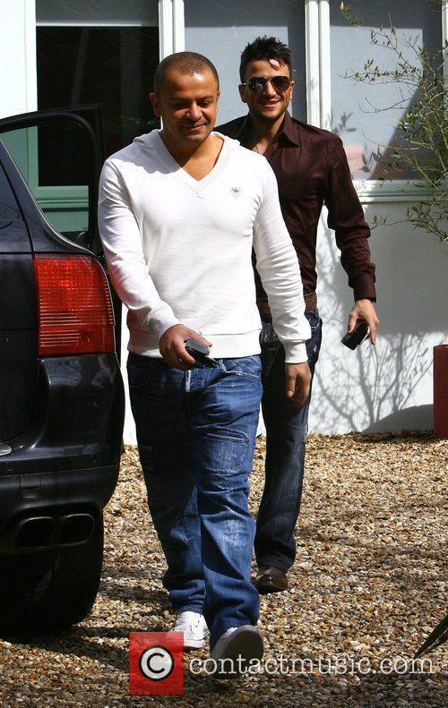 Peter Andre leaving his house with his brother...