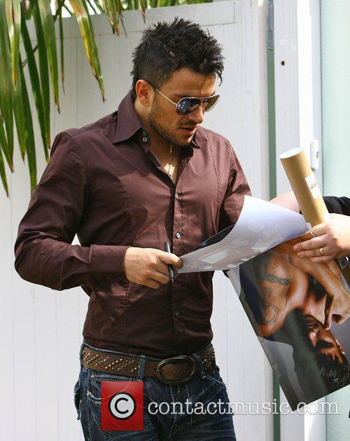 Peter Andre signs autographs as he leaves his...