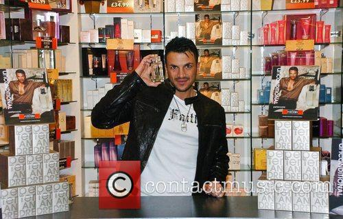Peter Andre  promoting his new fragrance 'Unconditional'...